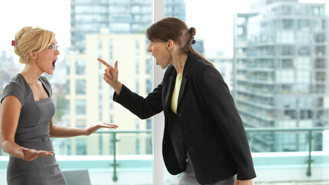 Two angry women having an argument, one pointing her finger at the other - Anger Management