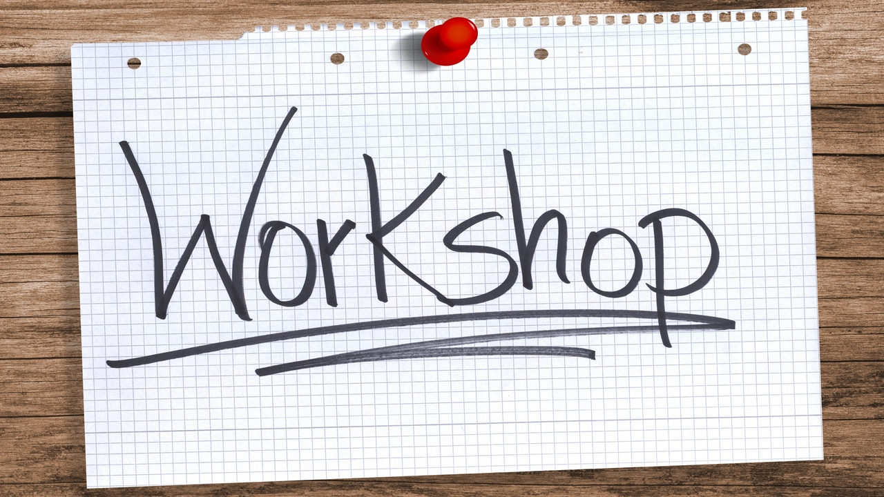 'Workshop' written on a sheet of paper pinned to a wooden board - CPD Training, Workshops and Events