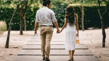man and woman walking on a pathway holding hands - Maintaining strong relationships