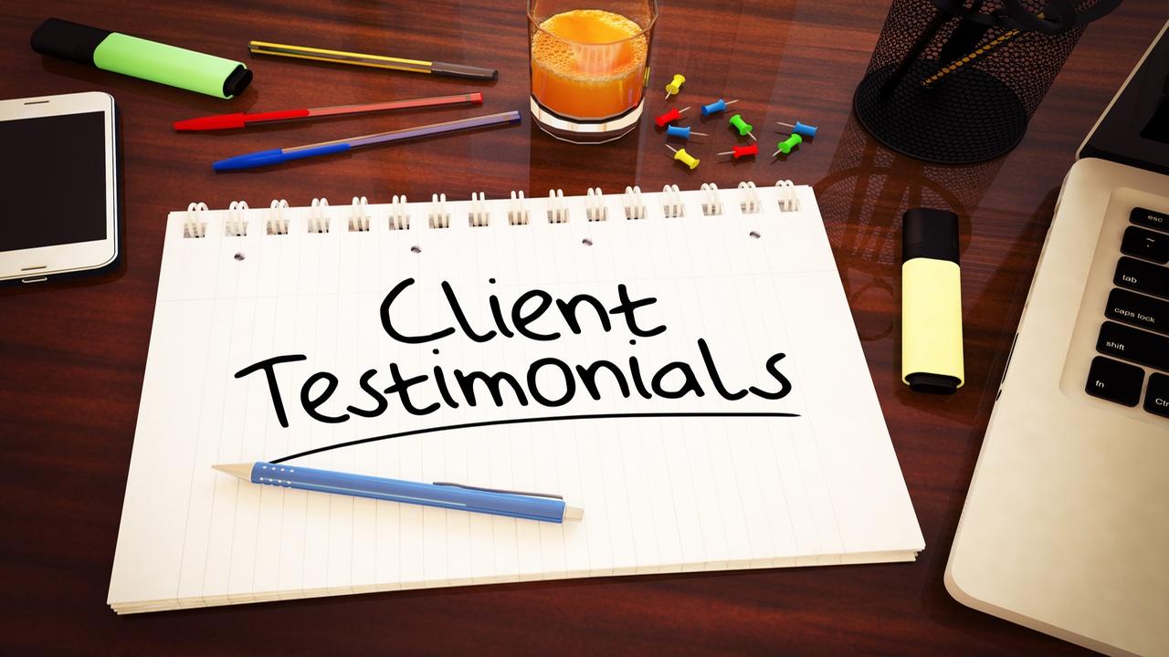 client testimonials written on a jotter