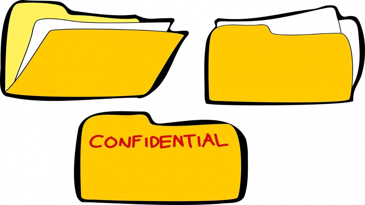 Three folders, one marked Confidential - Client Confidentiality